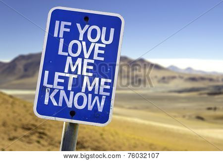 If You Love Me Let me Know sign with a desert background
