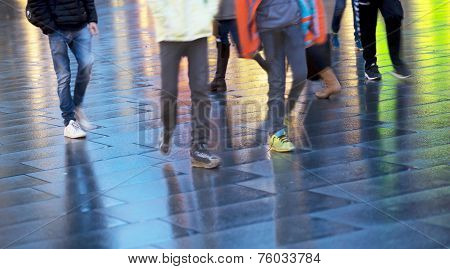 People Walking On Wet Pavement