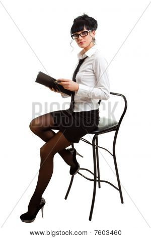 Businesswoman On Chair With Folder In Hands