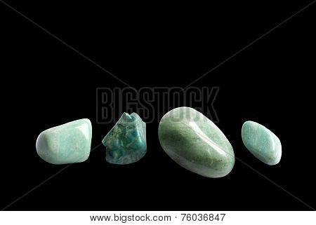Four green stones