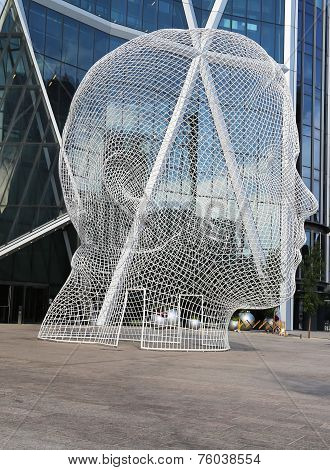 Wonderland sculpture by Jaume Plensa in the front of the Bow Tower in Calgary