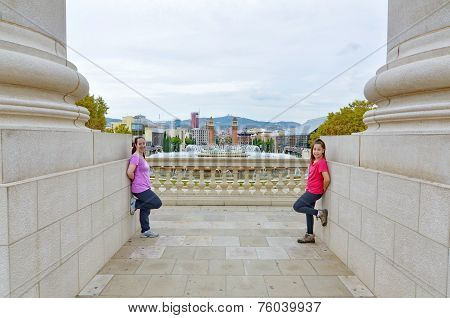 Two Sisters In Front Of The Magic Fountain In Montjuic, Barcelona, Spain