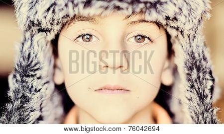 Portrait of little boy with winter hat of aviator