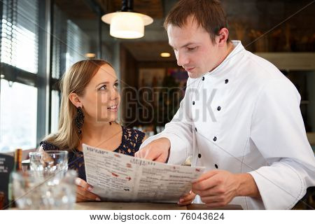 Chef discussing the menu with guest