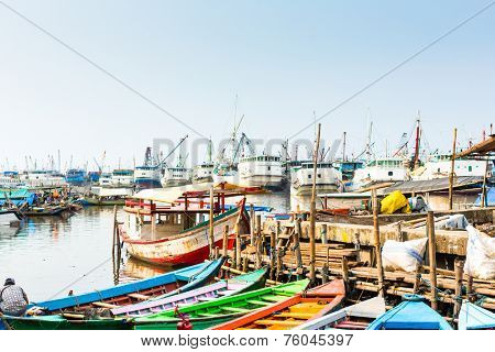 Sunda Kelapa old Harbour  with fishing boats, ship and docks in Jakarta, Indonesia