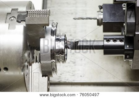 shaft detail turning on metal cutting machine tool at manufacturing factory