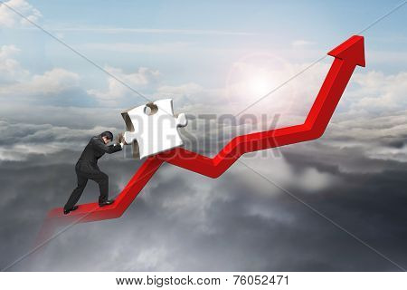 Businessman Pushing 3D Jigsaw Puzzle Upward On Red Trend Line