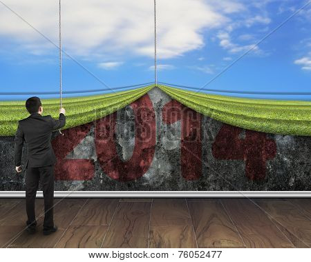 Businessman Pulling Down Natural Sky Curtain To Cover Old 2014