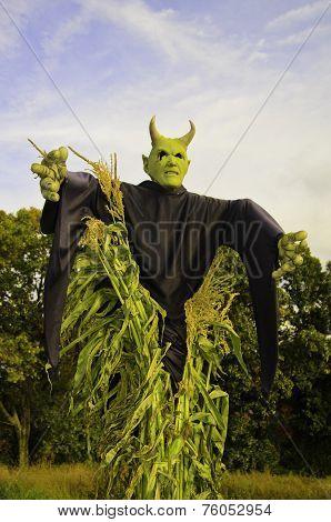 Scarry demon in a corn field