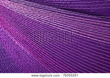 Colorful Stitching Forming Pattern On Mauve Fabric