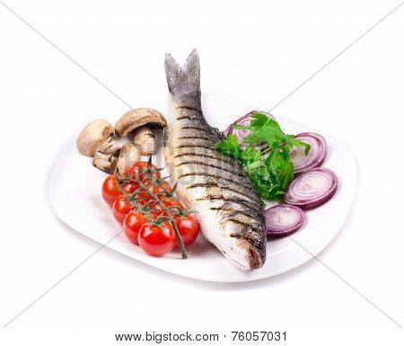 Grilled seabass on plate with mushrooms.
