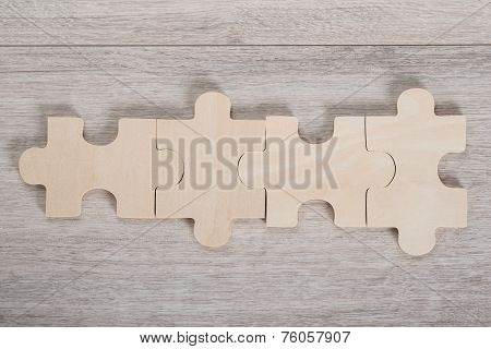 Wooden Jigsaw Pieces On Table
