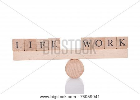 Life And Work Blocks Balancing On Seesaw