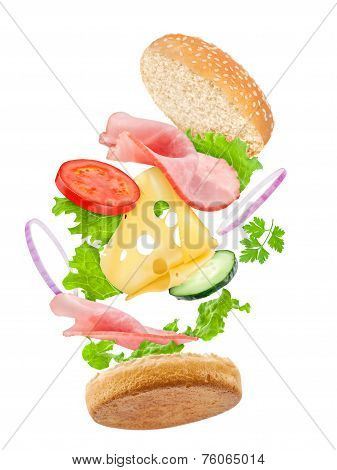 Falling Delicious Sandwich With Ingredients: Ham, Cheese, Tomato, Cucumber, Onion, Lettuce
