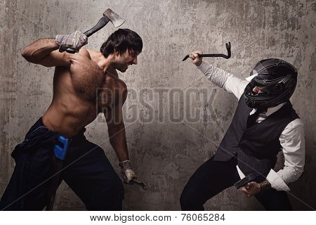 Two men fight with construction tools
