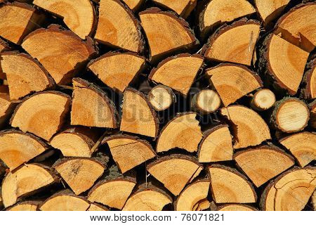 Stacked chopped wood for the winter or construction as background