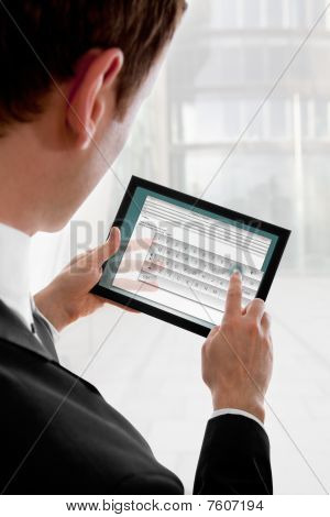 Businessman Holding A Touchpad Pc, Writing An E-mail