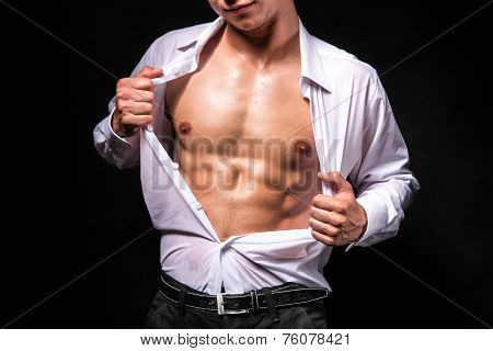 Muscular Man Showing His Chest During Striptease