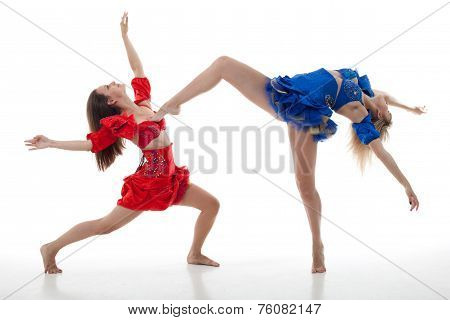 Two Women Dance On A White Background