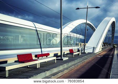 Vertical View Of Tramway Crossing The Bridge