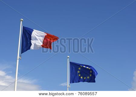 Close-up of the flags of the European Union and France.