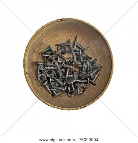 vintage brass tray with tacks nails over white, clipping path
