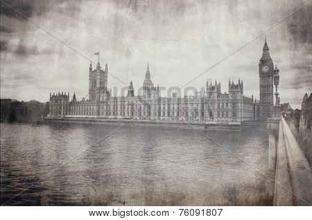 Aged vintage greyscale image of Houses of Parliament and Big Ben in London viewed from across the River Thames