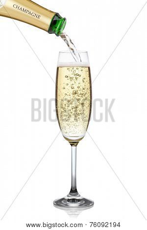 Champagne pouring into a glass, isolated on the white background, clipping path included.