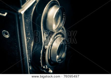 Vintage twin reflex camera isolated on a black background