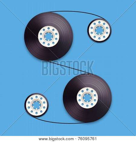 A vector illustration of a recordable bobbin of tape cassette. Letter S