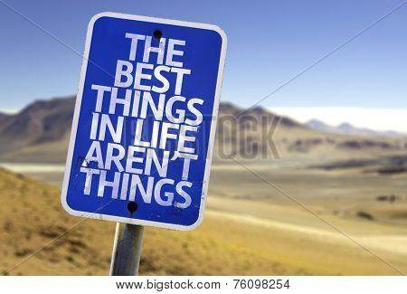 The Best Things In The Life Aren't Things sign with a desert background