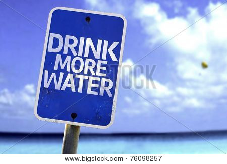 Drink More Water sign with a beach on background