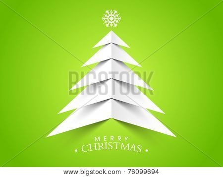 Merry Christmas celebrations with beautiful paper X-mas tree and stylish text on green background.