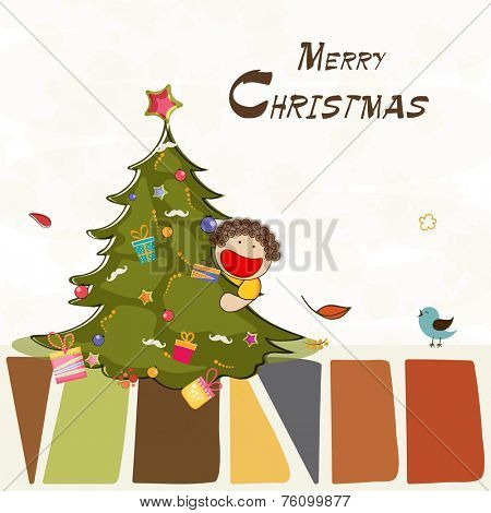 Cute little boy holding X-mas tree on occasion of Merry Christmas celebration.
