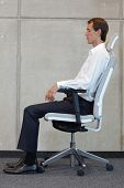 pic of rest-in-peace  - business man on chair in correct sitting position  - JPG