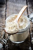 picture of ladle  - White flour in the ladle on wooden backgroundselective focus - JPG