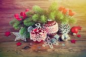stock photo of conifers  - Branch of Christmas tree with tinsel and balls - JPG