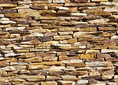 picture of gneiss  - Colorful stone wall closeup in sunny day - JPG