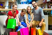 stock photo of mall  - Family with kids shopping in mall having a break - JPG