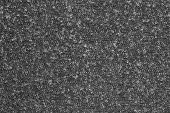 stock photo of outerwear  - abstract textural background from knitted fleecy synthetic fabric of black color for tailoring of warm outerwear - JPG