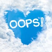 image of oops  - oops word on blue sky inside love heart cloud form - JPG