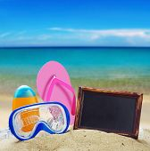 stock photo of blue things  - blackboard and things for the beach against the blue sea - JPG