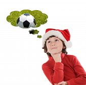 picture of ball cap  - Adorable child with Christmas hat thinking with a soccer ball isolated on a white background - JPG