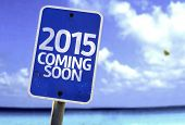image of say goodbye  - 2015 Coming Soon sign with a beach on background - JPG