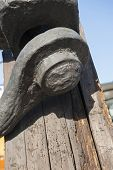 picture of shackles  - Closeup detail of old marine shackle on rotting wooden mast  - JPG