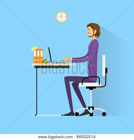 business man sitting at desk in office working laptop