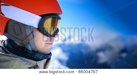Close up of the ski goggles of a man with the mountains at background