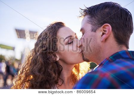 couple kissing in public together in public place