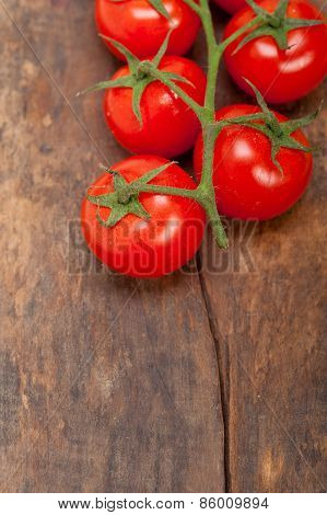 Fresh Cherry Tomatoes On A Cluster