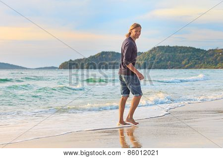 happy young manl on the beach